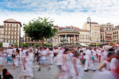 PAMPLONA, SPAIN - JULY 10: People in the square Castillo at San — Stock Photo
