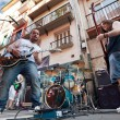 Foto de Stock  : PAMPLONA, SPAIN - JULY 8: musicians play on street during Sa