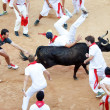 Stockfoto: PAMPLONA, SPAIN - JULY 9: People having fun with young bulls at