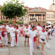 Stock Photo: PAMPLONA, SPAIN - JULY 10: People in square Castillo at SFerm