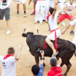 PAMPLONA, SPAIN - JULY 10: People having fun with young bulls at — Stock Photo #36484321