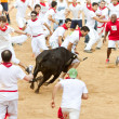 Zdjęcie stockowe: PAMPLONA, SPAIN - JULY 10: People having fun with young bulls at