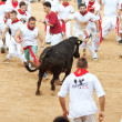 PAMPLONA, SPAIN - JULY 10: People having fun with young bulls at — Stock Photo #36484341