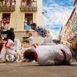 PAMPLONA, SPAIN-JULY 12: People run from bulls on street during — Stock Photo #36484441