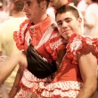 PAMPLONA, SPAIN - JULY 13: Young men in women's costumes await s — Stock Photo #36484451