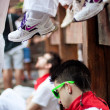 图库照片: PAMPLONA, SPAIN-JULY 13: Young msleeping in anticipation of s