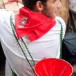 PAMPLONA, SPAIN-JULY 13: A young man with a funnel on street Est — Stock Photo