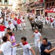 PAMPLONA, SPAIN -JULY 14: Unidentified men run from bulls in str — Stok Fotoğraf #36484567