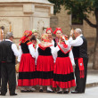 Stock Photo: PAMPLONA, SPAIN-JULY 14: People in traditional costumes at SF