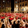 Foto de Stock  : PAMPLONA, SPAIN-JULY 14: People with red handkerchiefs at closin