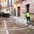 Stock Photo: PAMPLONA, SPAIN-JULY 14: Cleaning street after closing festival
