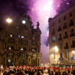 Stock Photo: PAMPLONA, SPAIN-JULY 15: People look at fireworks at closing of