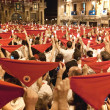 PAMPLONA, SPAIN-JULY 14: People with red handkerchiefs at closin — Stock Photo