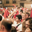 PAMPLONA, SPAIN-JULY 15: People with red handkerchiefs at closin — Stock Photo #36484641