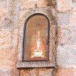 Small statue of SFermin in wall on street in Pamplona — Stockfoto #36488967