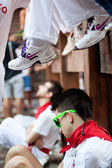 PAMPLONA, SPAIN-JULY 13: Young man sleeping in anticipation of s — Stock Photo