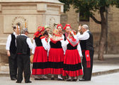 PAMPLONA, SPAIN-JULY 14: People in traditional costumes at San F — Stock Photo