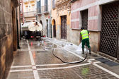 PAMPLONA, SPAIN-JULY 14: Cleaning street after closing festival — Stock Photo