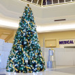 Christmas tree and medical centre - Stock Photo