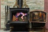 Old fireplace with a burning firewoods — Zdjęcie stockowe