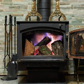 Old fireplace with a burning firewoods — Stock Photo
