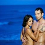 Couple hugging in ocean — Stock Photo #11084006