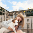 Stock Photo: Beautiful pregnant woman with funny dog on the balcony