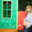 Beautiful Pregnant woman on the playground - Stock Photo