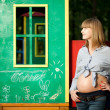 Beautiful Pregnant woman on the playground — Stock Photo #15359465