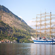 Tall ship in a bay - Stock Photo