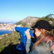 Tourist using telescope, Dubrovnik old town, Croatia - Stock Photo