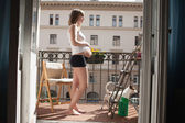 Beautiful pregnant woman on the balcony — Stock Photo