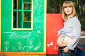 Beautiful Pregnant woman on the playground — Stock Photo