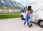 Happy young womans outside motorhome — Foto de Stock