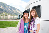 Young women in front of motorhome — Stock Photo