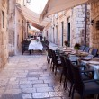 Street restaurant in heart of Dubrovnik old town, Europe - Stock Photo
