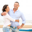 Portrait of a happy young couple having fun at the sea shore — Stock Photo