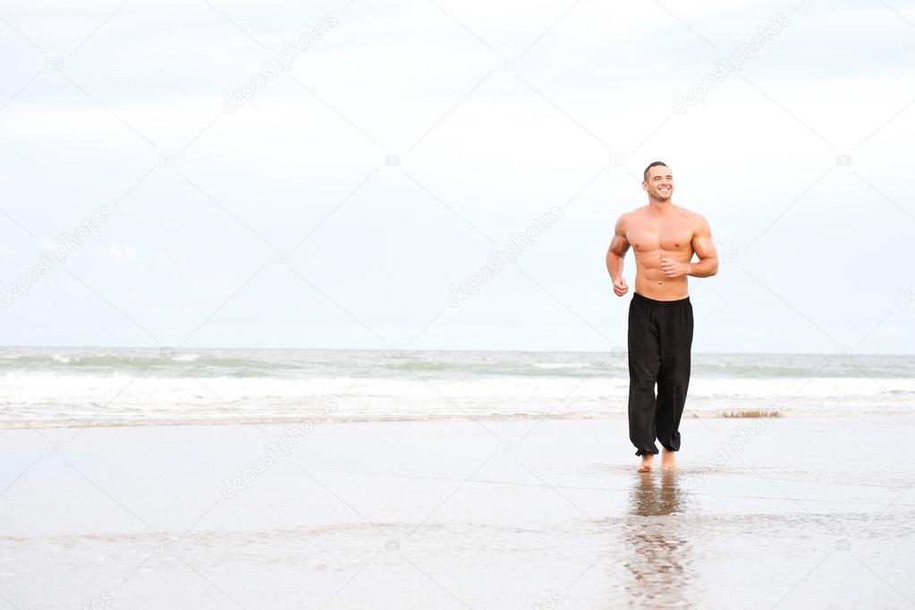 ... image young handsome muscular man running on the beach young handsome