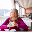 Young Woman at a Cafe — Stock Photo