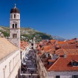 Tourists flock down main street in Dubrovnik - Stock Photo