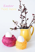 Decorative Easter eggs and a bunch of sprigs of cherry blossoms — Stock Photo