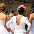 Beautiful women in a parade of brides in one of the European cities — Stock Photo