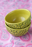 Two oriental national bright bowls on a pink background — Stock Photo