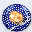 Sweet cottage cheese pancakes on a plate with stars and a fork — Stock Photo