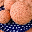 Three ball of pink yarn on talelke with asterisks — Stock Photo