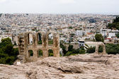 Ruins of the old city on the background of the new. Athens, Greece, Peloponnese. — Stock Photo