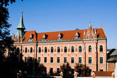 An old building with a tower in Krakow, Poland — Stock Photo