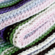 Knitting striped rug with white, purple, green and pink stripes — Foto Stock