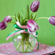 Delicate bouquet of purple tulips in a transparent vase — Stock Photo
