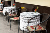 Tables with crocheted tablecloths at an outdoor cafe, Krakow, Poland, Europe. — Stock Photo